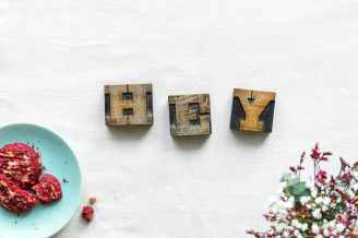three brown wooden letters wall decor